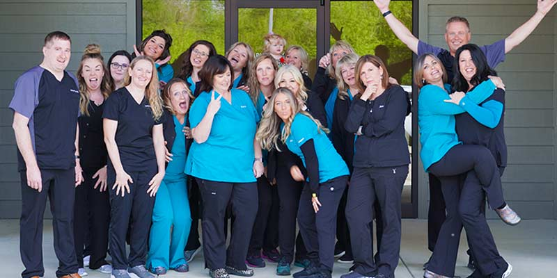 jackson-pediatric-dentistry-staff-picture-in-front-of-office